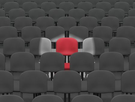 digital render of an empty auditorium of grey chairs with a single red chair lit by a spotlight Stock Photo