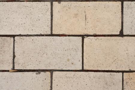 Betegelde mozaïek betonnen stoep  Stockfoto