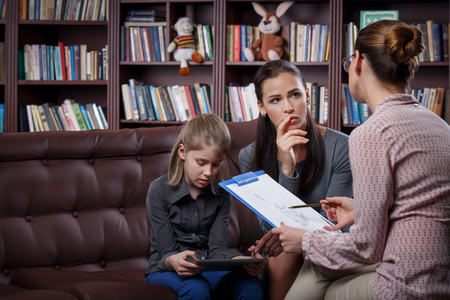 parenthood: Young mom with her daugher at psychologist consultation