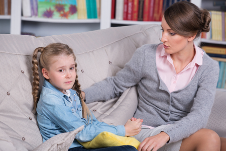 female child: Child psychologist with a little girl, a child is crying