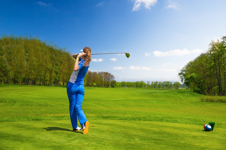 woman golf: Woman golf player hitting by iron from fairway