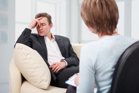 oppressed: Oppressed man with a problem on a reception for a psychologist