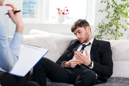 dipsomania: Oppressed man with a problem on a reception for a psychologist