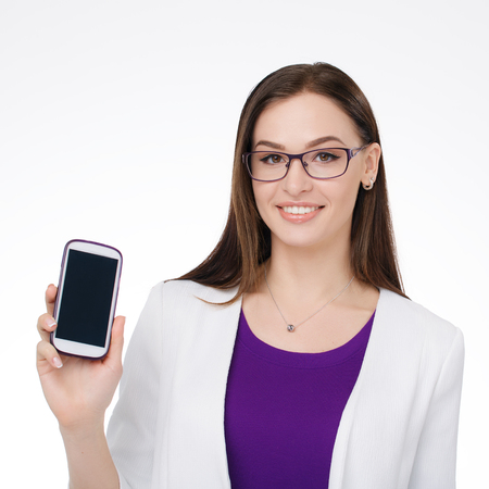 personal organiser: young businesswoman smiling with cell phone in the hand Stock Photo