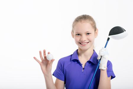 teen golf: golfista bonito de la muchacha en el fondo de color blanco en el estudio Foto de archivo