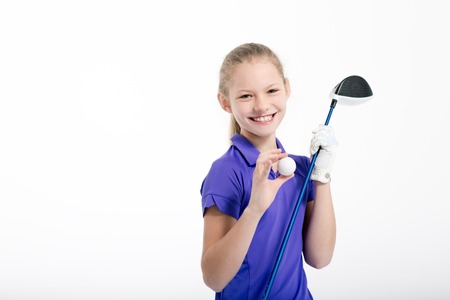 Pretty girl golfer on white backgroud in studio Standard-Bild