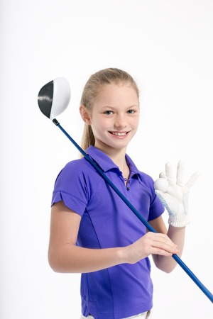 Pretty girl golfer on white backgroud in studio Stock Photo