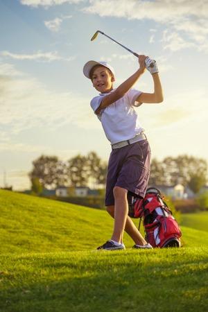 Boy playing golf Stock fotó