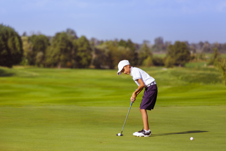 Boy playing golf Stock Photo