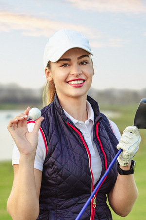 young beautiful woman is training golf in autumn Stock Photo