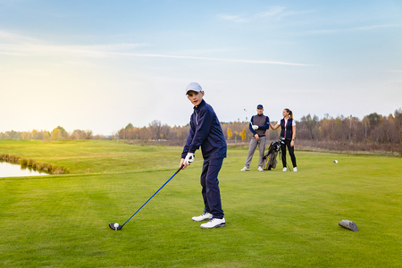 Happy family is playing golf in autumn Stock Photo