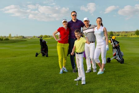 Friends golfers with kid happy to finish their golf game Stockfoto