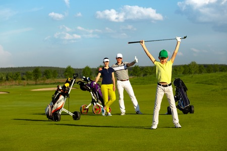 The boy with his family playing golf