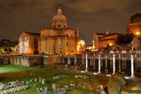 severus: Santi Luca e Martina church and Roman Rorum in Rome. The church was initially dedicated to Saint Martina, martyred in 228 AD during the reign of Emperor Alexander Severus. In 625 Pope Honorius I commissioned construction of the church. Stock Photo