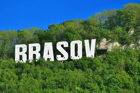 name day: The name of the Brasov city in Romania in volumetric letters on Tampa mountain, on a summer day
