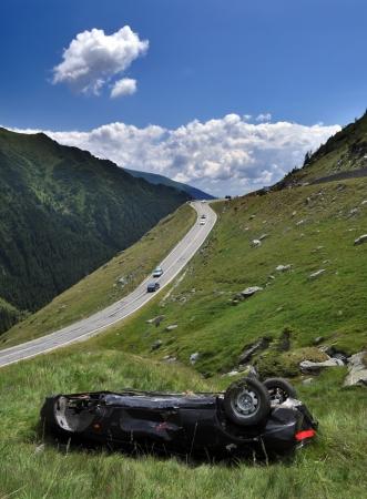 dangerous road: Car crash on a high mountain road Stock Photo