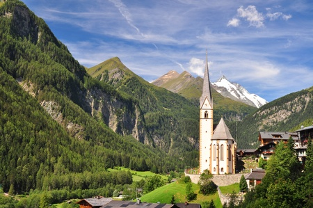 austrian village: Heiligenblut church in front of Grossglockner peak, Austria Editorial