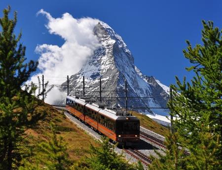 glacier: Mountain train in front of Matterhorn peak