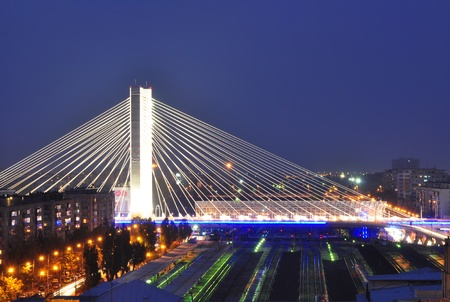 Basarab bridge and North Railroad Station at dusk, Bucharest, Romania photo