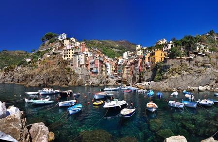 Boats in Riomaggiore, Cinque Terre, Italy photo