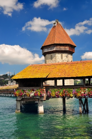 Chapel Bridge and Water Tower in Luzern, Switzerland photo