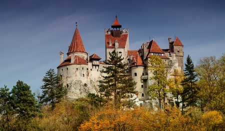 Bran Castle in autumn landscape, Romania