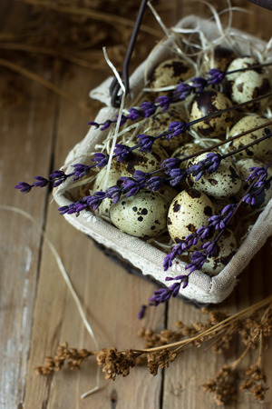 kinfolk: Quail eggs in wire basket, with lavender twigs on barn wood, Easter, simplicity, inside countryside