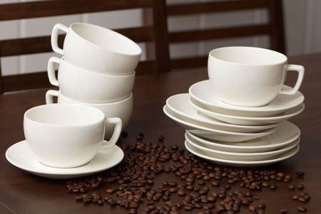 Cups for coffee with coffee grains on a dark wooden table Stock Photo - 6273254