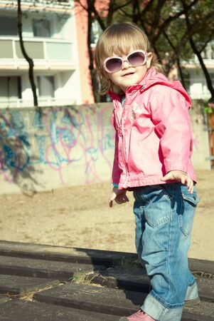 Portrait of a beautiful little girl outdoor in sunglasses. Stock Photo - 6284513