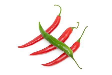 diagonally: Color chili peppers diagonally on a white background Stock Photo