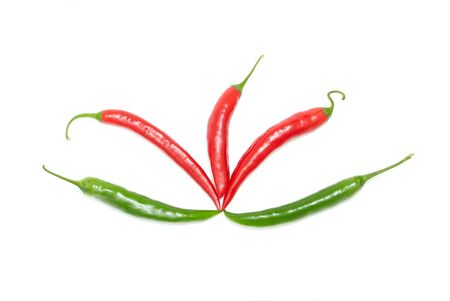 Colored chili peppers on a white background