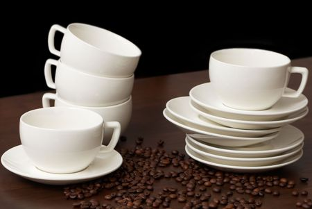 Cups for coffee with coffee grains on a dark wooden table Stock Photo - 6340682