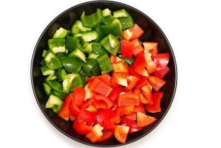 diagonally: Variation of red and green peppers on a plate diagonally