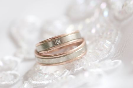 Two wedding rings on a dress