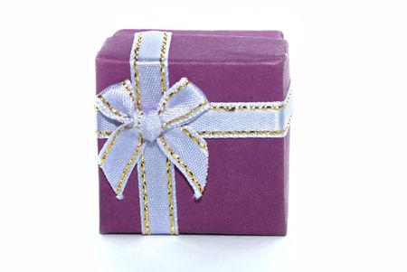 Violet gift box isolated on white photo