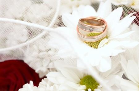 Wedding rings in wedding bouquet photo