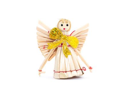 Straw angel isolated on white photo
