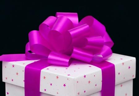 White gift box isolated on black photo