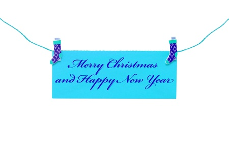 Christmas greeting card hanging with clothespin