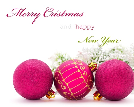 Christmas greeting card with pink baubles and sample text photo