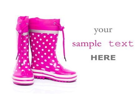 wellie: Pink rubber boots for kids isolated on white background (with space for text)