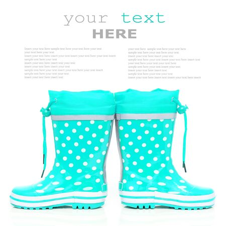wellie: Cyan rubber boots for kids isolated on white background (with sample text)