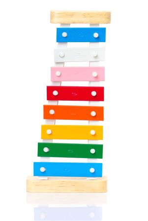 Colorful wooden metal xylophone isolated on white Stock Photo