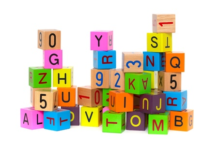 tower block: Wooden blocks with letters and numbers on white background Stock Photo