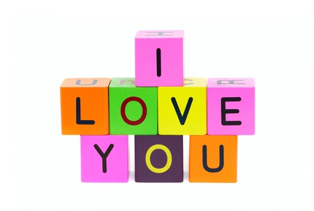 I love you - words formed from alphabet blocks isolated on a white background photo