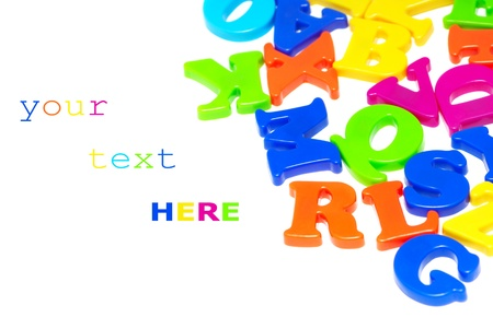 Colorful magnet letters isolated on white background (with space for sample text)