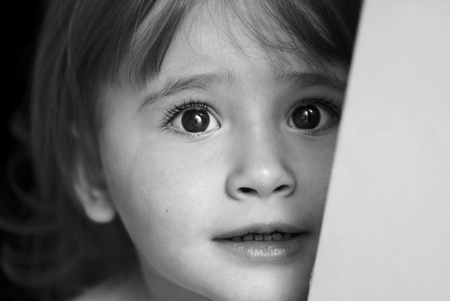 Little girl with eyes full of scare and sadness Stock Photo - 9015623