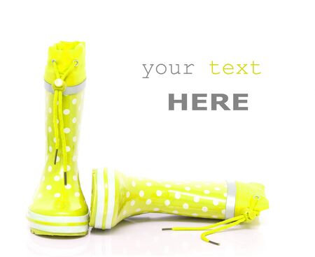 wellie: Yellow rubber boots for kids isolated on white background (with space for text) Stock Photo