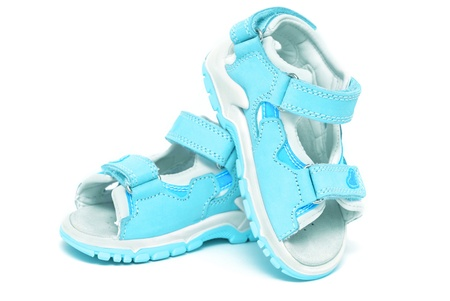 Blue childs sandals isolated on white Stock Photo