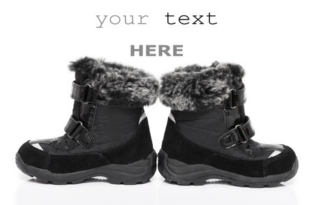 Black childs winter boots isolated on white background (with space for text) photo